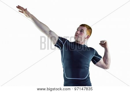 Muscular rugby player pointing to the sky on a white background