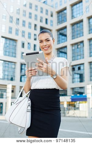 Young Businesswoman Holding A Digital Tablet In Hands Outdoors