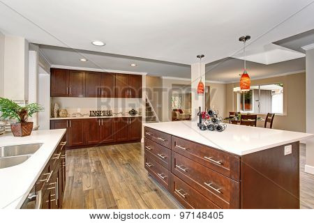 Large Kitchen With White Counter Tops.