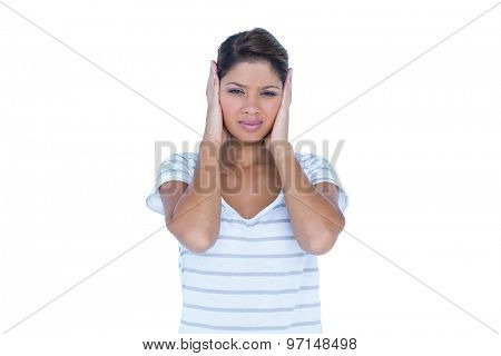 Pretty brunette hiding her ears on white background