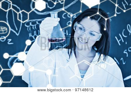 Science graphic against close up of a cute scientist looking at a conical flask