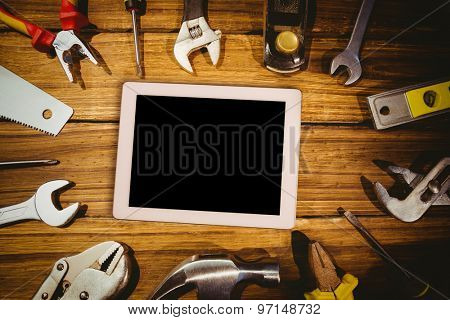 Tablet pc against tools on desk