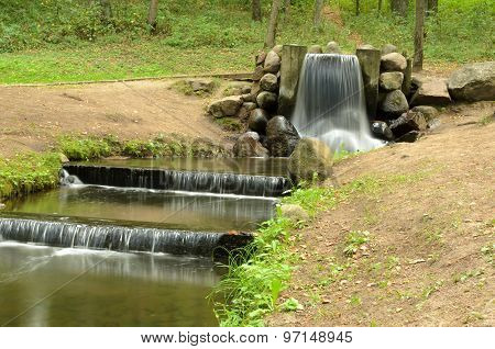 Waterfall In The Summer Park