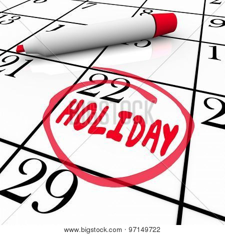 Holiday word circled on calendar date or day to remind you of a vacation, break or time off from school or work to relax and enjoy life away from stress
