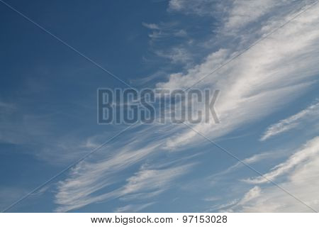Abstract White Fluffy Clouds In The Blue Sky