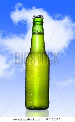Cold Frosted Beer Bottle With Frost Bubbles In Green Glass Bottle Isolated Blue Sky
