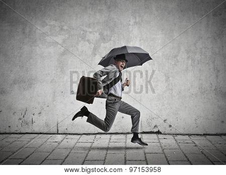 Running manager holding an umbrella