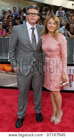 NEW YORK-JUL 27: Director Christopher McQuarrie (L) and wife Heather McQuarrie attend the US Premiere of 'Mission: Impossible - Rogue Nation' in Times Square on July 27, 2015 in New York City.