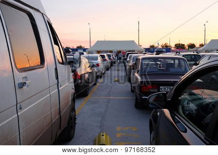 Russia, Caucasus Port, July, 14, 2015: hundreds of cars gathered in turn on a ferry through the Strait of Kerch from the Russian Port Caucasus to the Crimea. Expectation lasts for many hours