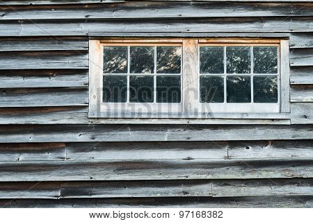 Weathered Barn Wall with Overlapped Wood Siding with Two Windows