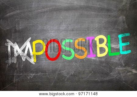 Impossible/Possible written on a chalkboard