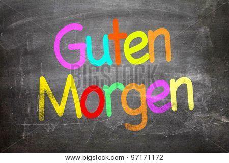 Good Morning (in German) written on a chalkboard