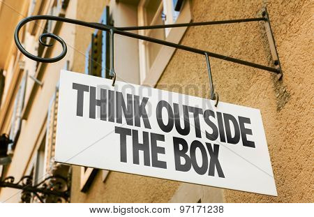 Think Outside the Box sign in a conceptual image