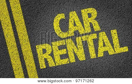 Car Rental written on the road