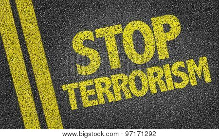 Stop Terrorism written on the road