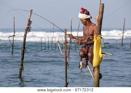 Local fishermen are fishing in unique style. South Sri Lanka in Indian ocean.