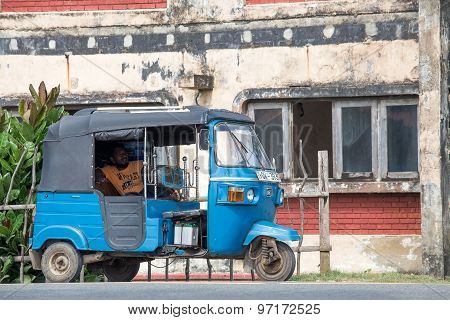 Auto rickshaw or tuk-tuk on the street of Hikkaduwa. Most tuk-tuks in Sri Lanka are a slightly modif