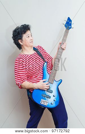 Portrait Of Adult Asian Woman With Electric Bass, Specialty Toned, Studio Shot