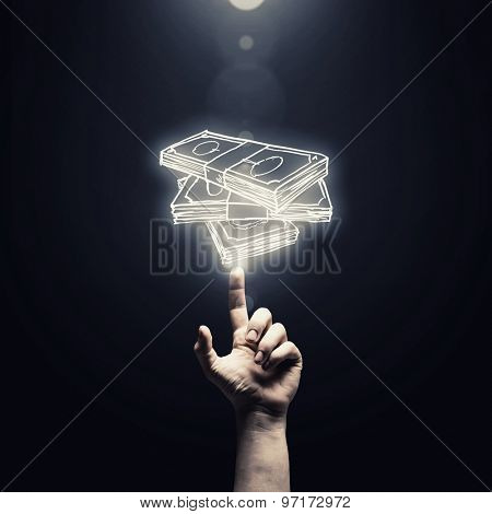 Close up of man hand pointing at money symbol