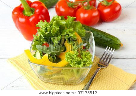 fresh vegetable salad in bowl on table close up