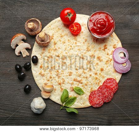 Ingredients for cooking pizza on wooden table, top view