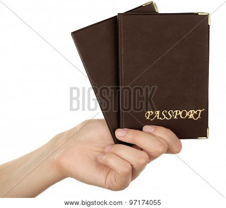 Female hand holding passports isolated on white