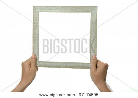 Female hands with wooden frame, isolated on white