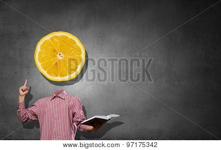 Headless businessman with lemon instead of head