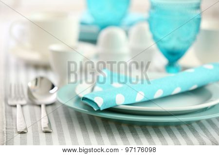 Beautiful holiday table setting in white and blue color