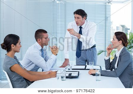 Manager talking to businesswoman in the office