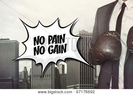 No pain no gain text with businessman wearing boxing gloves
