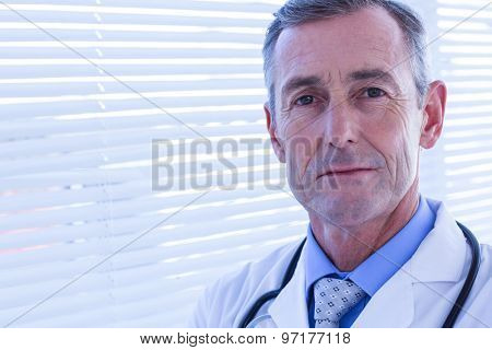 Confident male doctor looking at camera