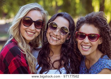 Happy hipsters in the park on a sunny day