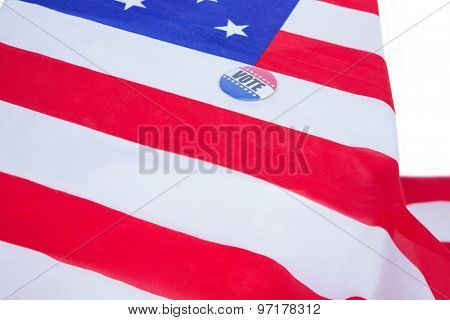 Badge put on American flag on white background