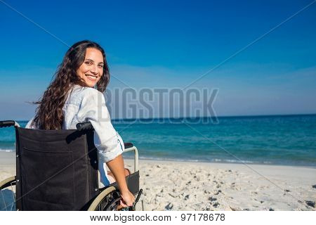 Disabled woman looking at camera on a sunny day