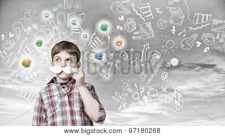 Kid boy having fun with decorative mustache over colorful background