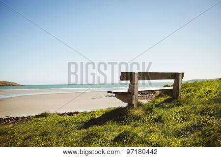 Stone bench near the sea on a sunny day