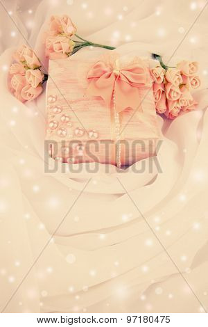 Beautiful hand made casket and flowers on light cloth background
