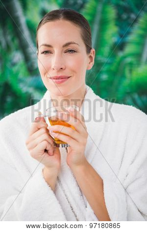Close up of a beautiful young woman drinking tea over white background