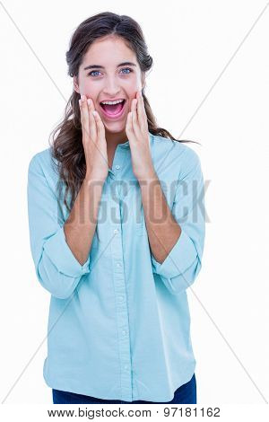 Surprised pretty hipster looking at camera with hands on cheeks on white background