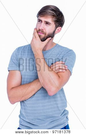 Handsome man thinking with hand on chin on white background