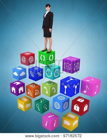 Businesswoman standing against blue vignette background