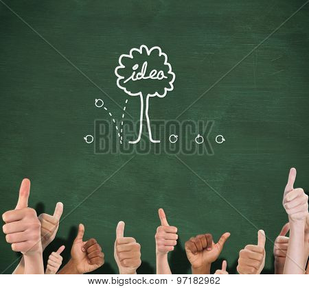 Hands showing thumbs up against green chalkboard