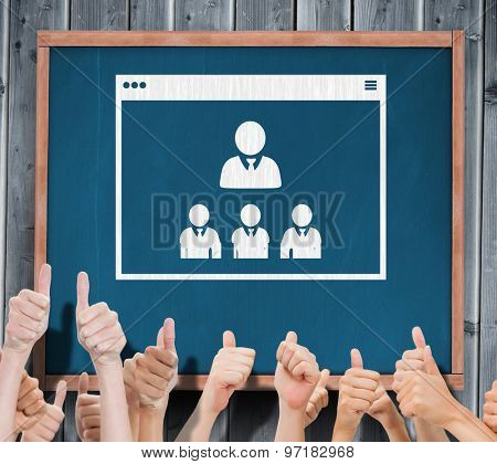 Group of hands giving thumbs up against blackboard with copy space on wooden board