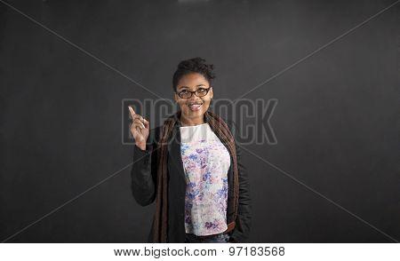 African Woman Good Idea On Blackboard Background