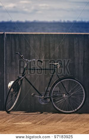 Classic Vintage Black Bicycle Leaning Against Wall