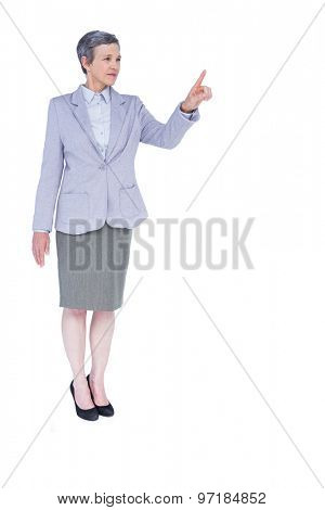 A serious businesswoman with grey hair gesturing on white background