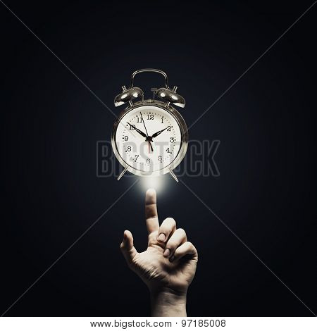 Close up of man hand pointing at clock watch symbol