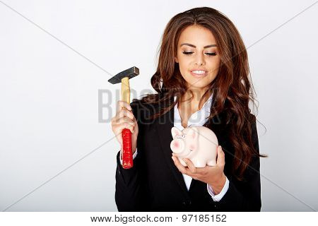 young woman smashed piggy bank