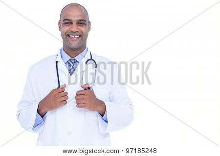 Smiling doctor looking at camera on white background